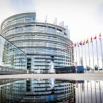 Building of the European parliament in Strasbourg - Reflection of Louise Weiss building in water puddle - Fall season